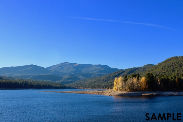 Photo of Lake Siskiyou in Autumn. Lake Siskiyou formed as a result of the Box Canyon Dam on the Sacramento River. Lake Siskiyou is near Mount Shasta in Northern California, USA. Deep hues of blue and green with autumnal forest in the backdrop.